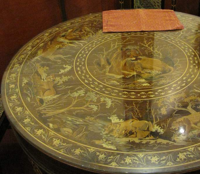 photo of table top with lion inlay in wood