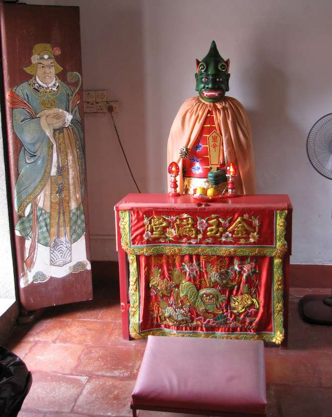 Statue of with green skin and painting at the Old Chinese Temple