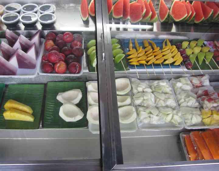 photo of prepared fresh fruit including papaya, watermelon and mango.