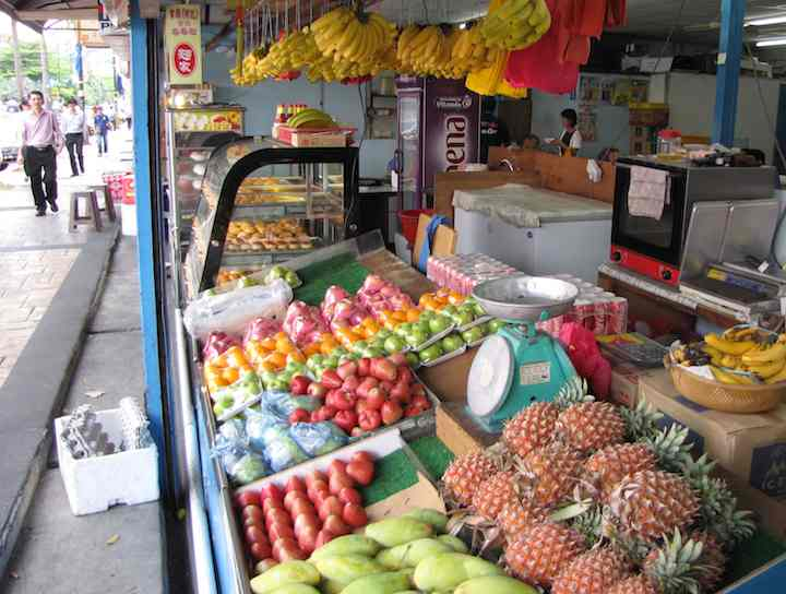 photo of whole fresh fruit including pineapples, mangos and bananas