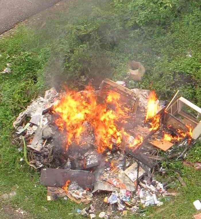 photo of a burning trash pile in Johor Bahru