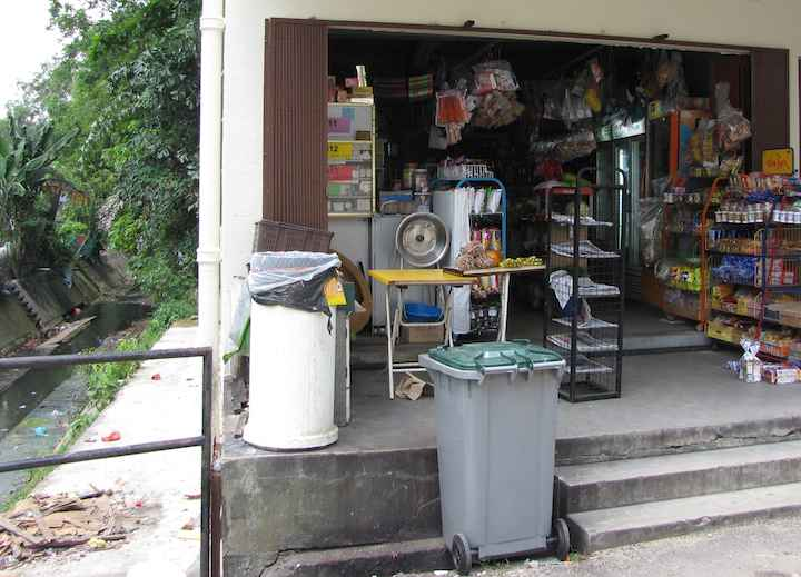 photo of a small neighborhood grocery store in JB