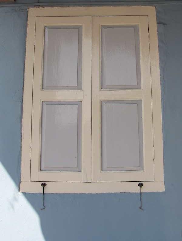 photo of Window shutters on blue wall