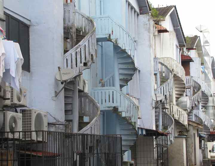 photo of spiral stairways in alley