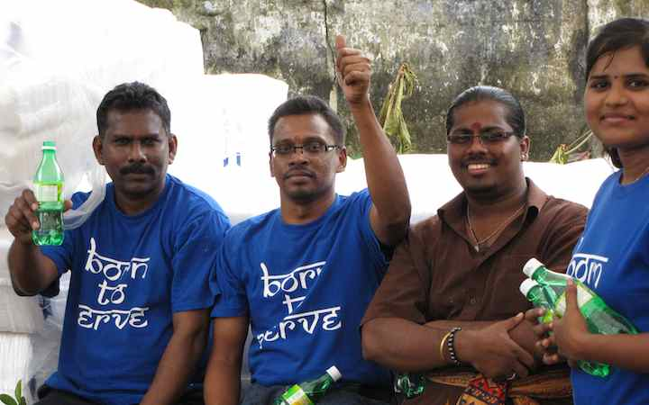 4 smiling people at Thaipusam