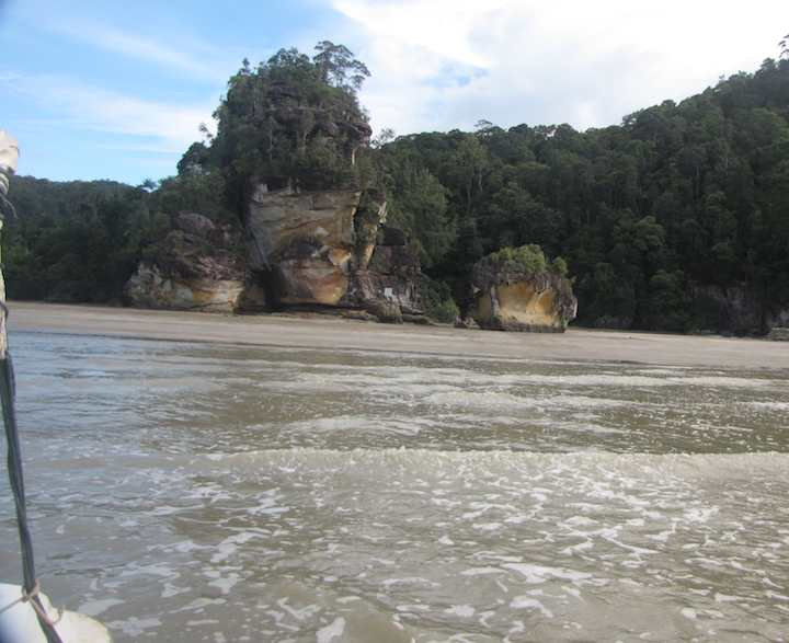 photo looking back at Bako National Park from the boat as I leave