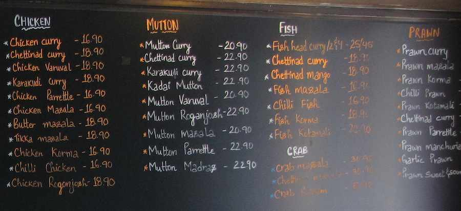 Tandoori Mahal Indian Restaurant menu items written on the wall
