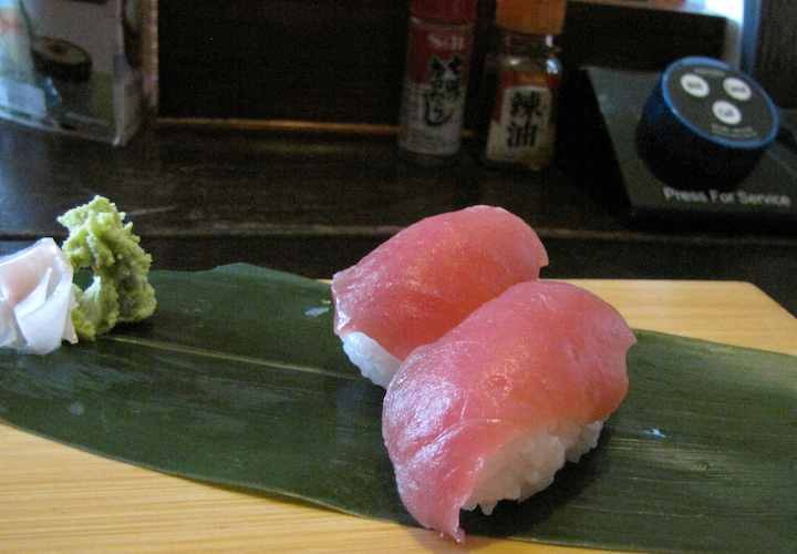 photo of two pieces of sushi