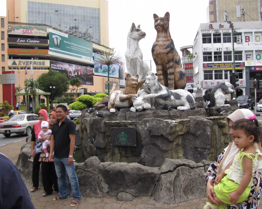 Cat monument, with people posing in front